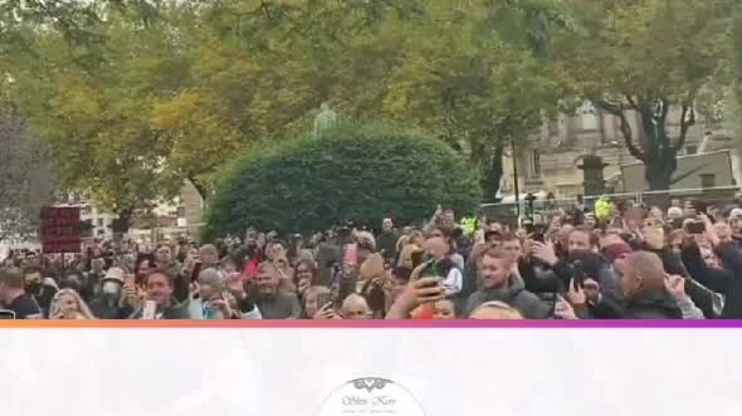 Crowd singing during covid protest