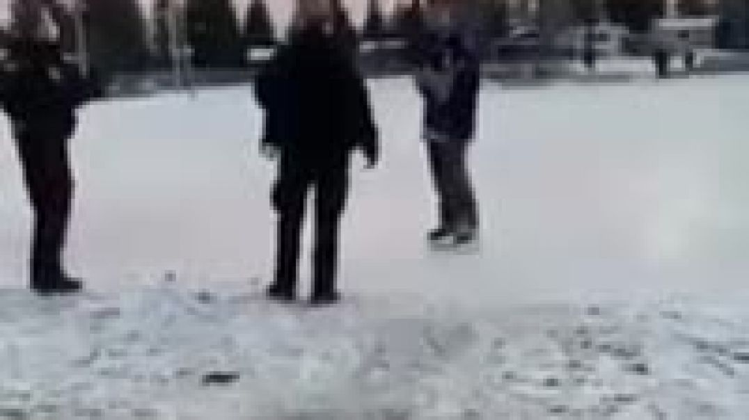 Police in Calgary, Alberta, Canada arrest a man for skating on an outdoor rink