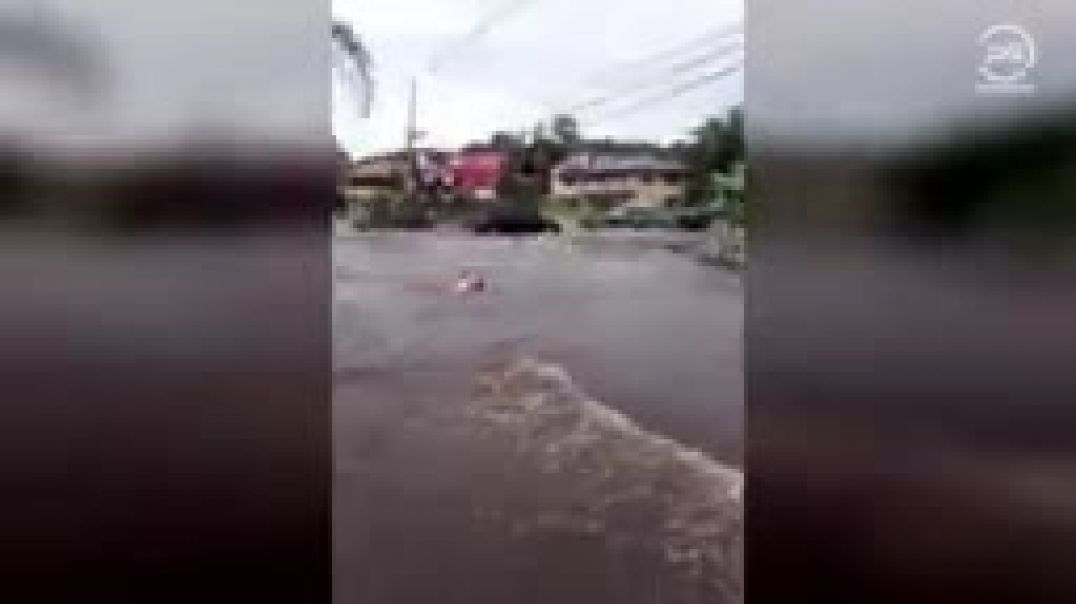 A devastating flood swept cars into the blue waters of Florianopolis, Brazil_144p