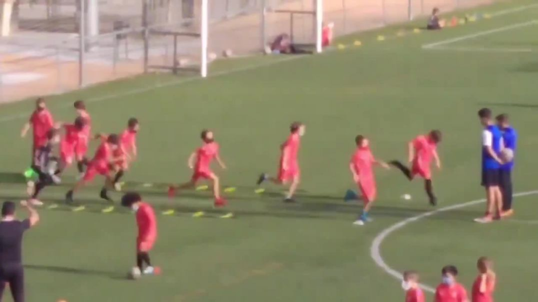 Spain This is insane They are making children wear masks whilst Soccer/Football training