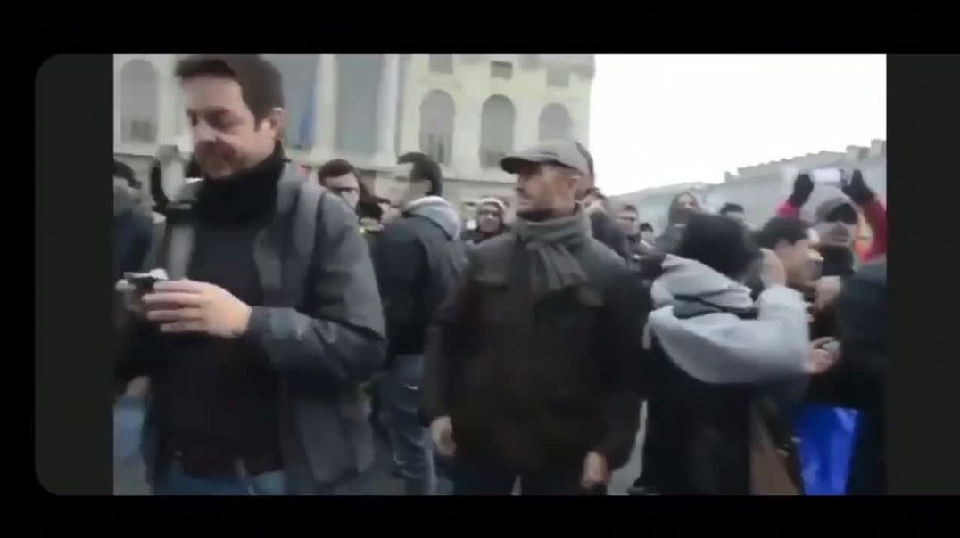 Police in Italy take off their helmets and join the protesters March 25th