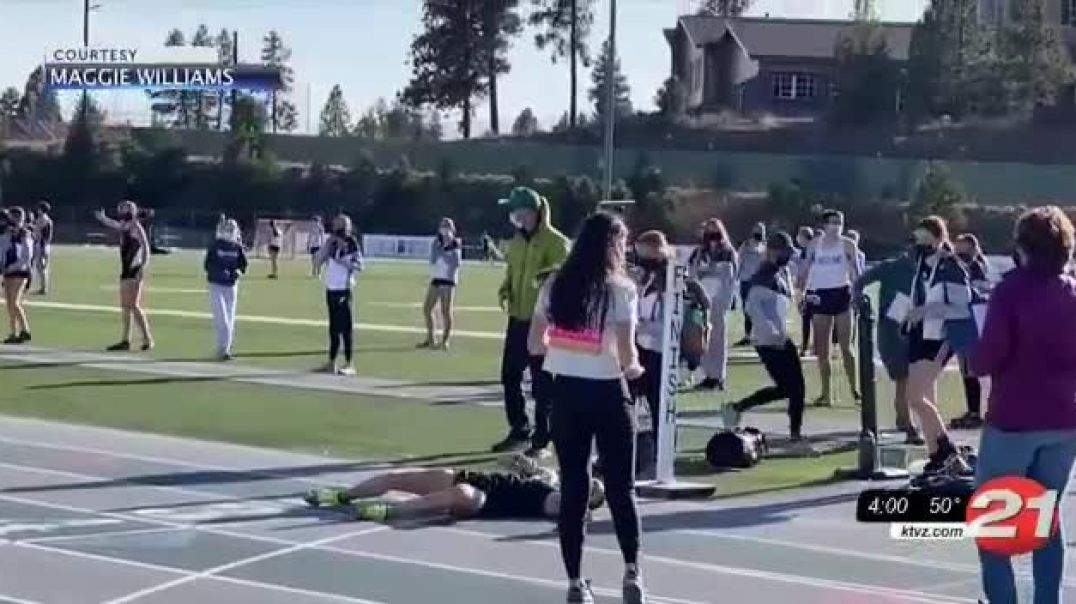 Runner passes out on track lack of oxygen MASKS!