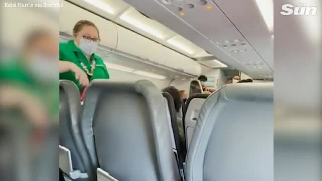 Dumb brain dead SHEEPLE laugh and applaud as MASKLESS woman is thrown off flight