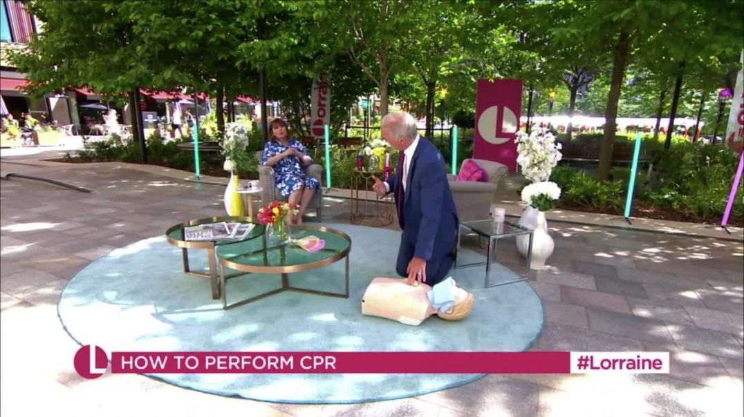 DR HILARY DOES CPR WITH MASK OVER MOUTH AND NOSE