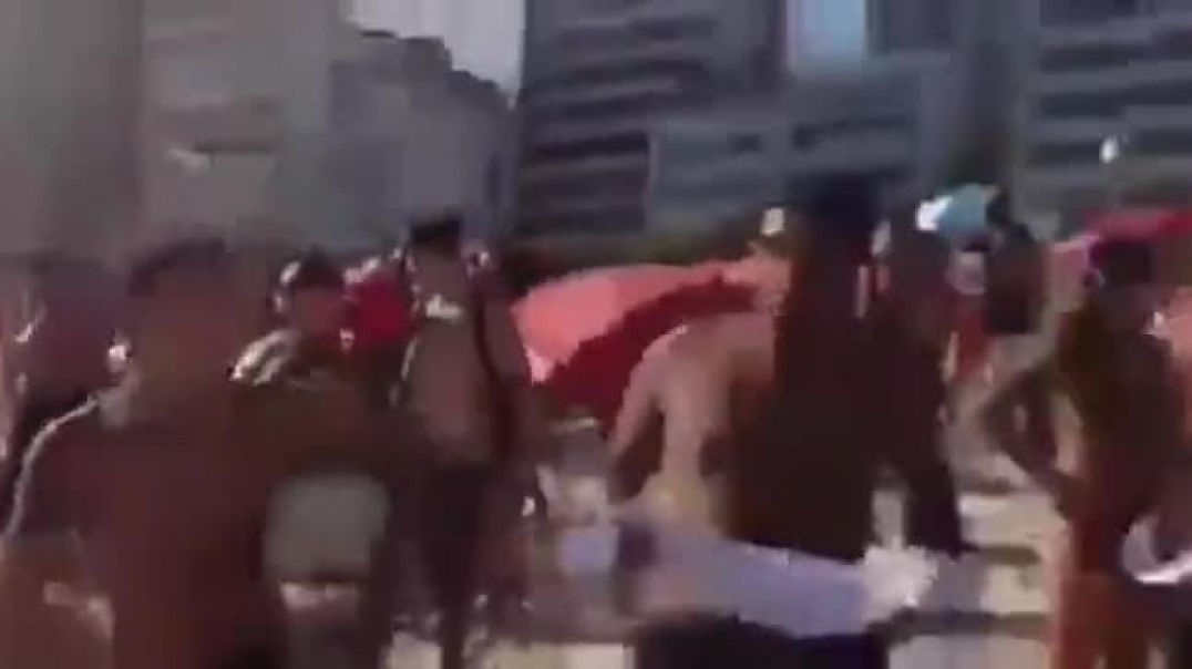 BRAZILIAN COPS TRY TO CLOSE THE BEACH, BUT LOCALS KICKED THEIR ASS & CHASED THEM OFF