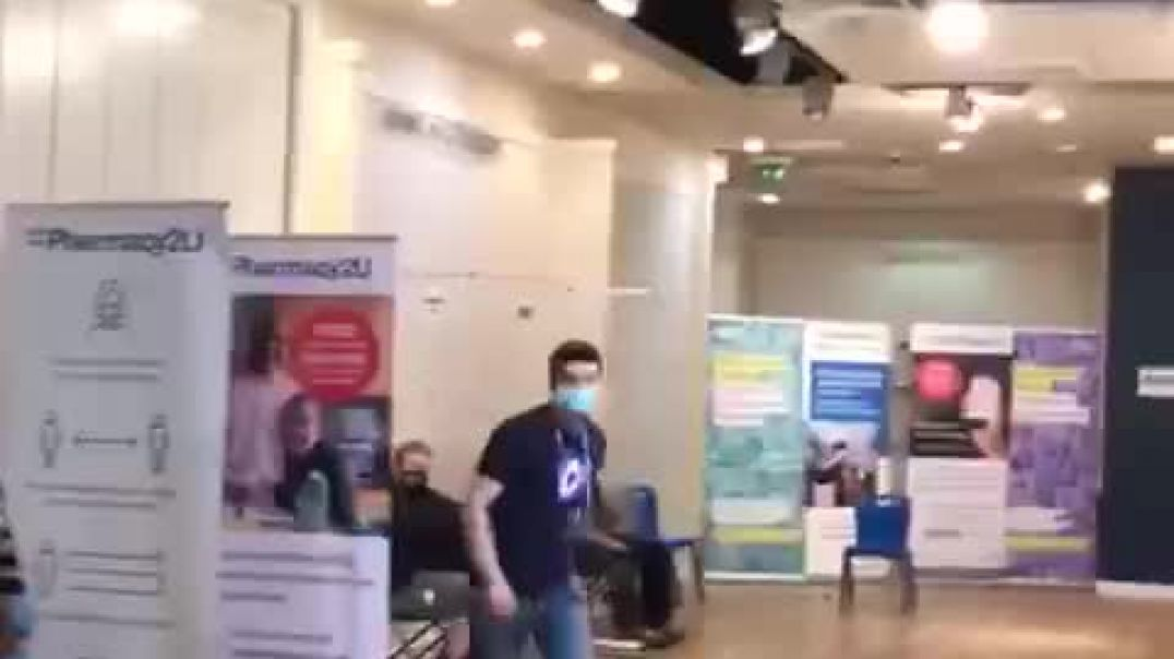 Man Walks In Vaccine Center & Try's To Wake The Fools Up