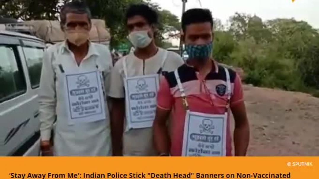 wtf in india Those, who have not been vaccinated are made to wear stickers with the sign of a skull