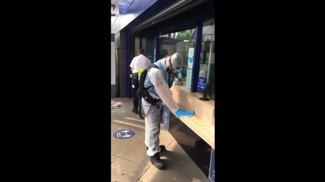 FAKE cleaning COVID photos in HAZMAT SUITS for use by Main Stream Media in England