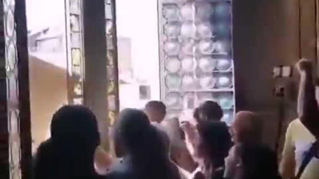French citizens storm a town hall, take down president Macrons portrait, then publicly destroy it.