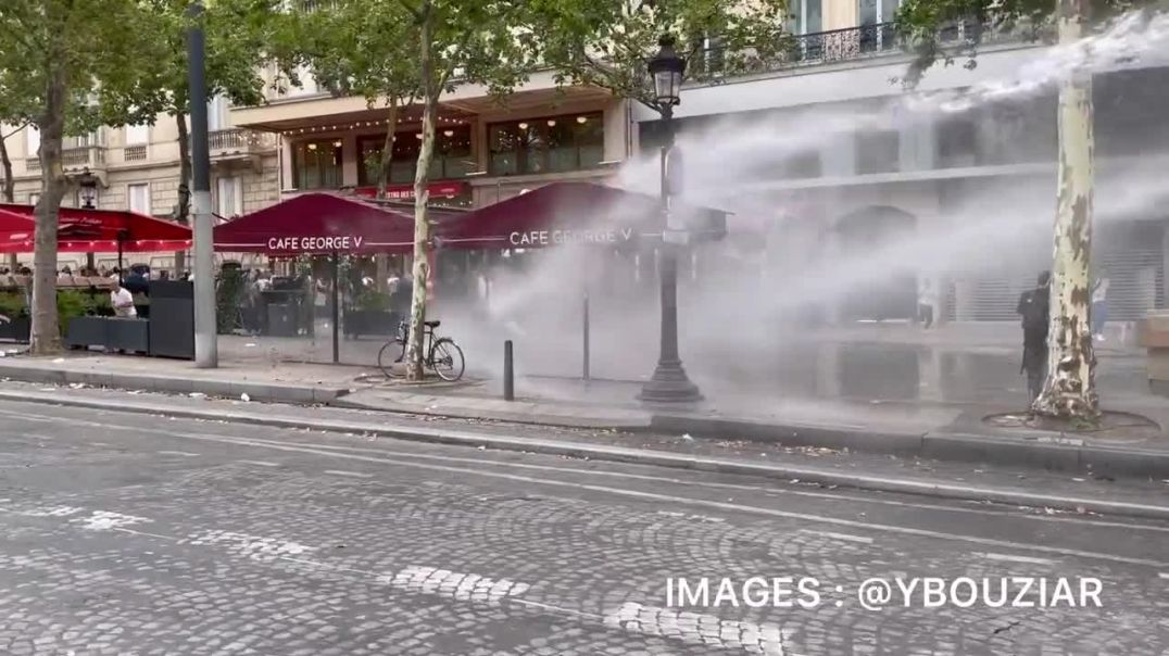 French police bring out the water cannons