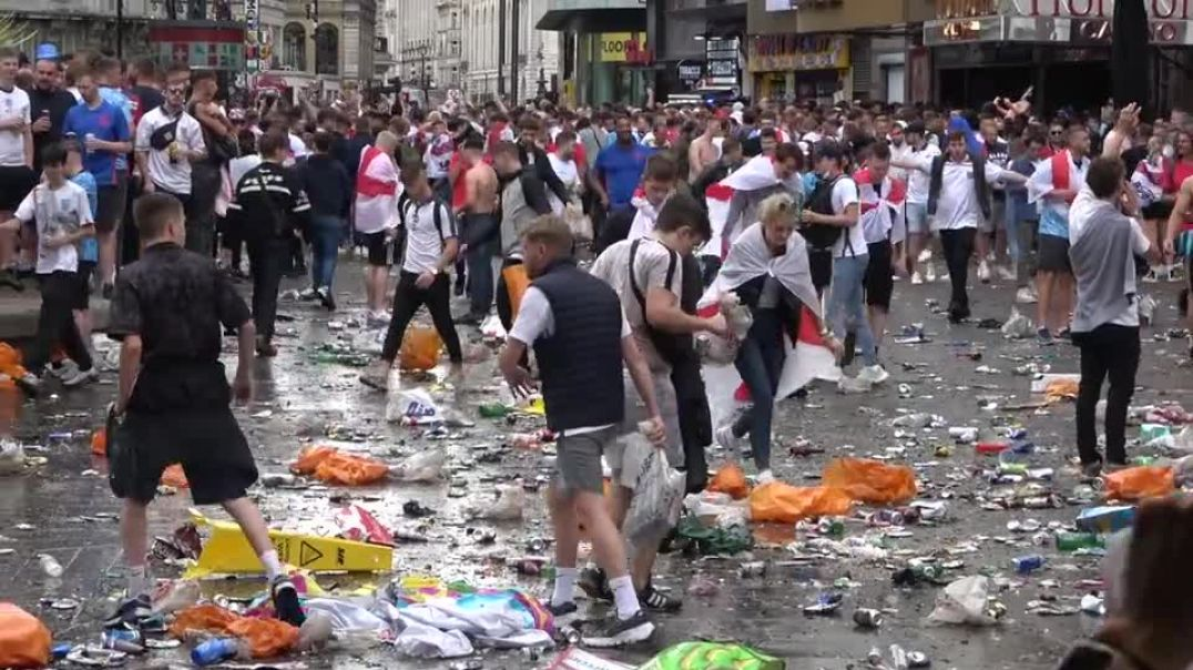 English YOBS and SORE LOSERS trash Leicester Square (London) after England lost the match yesterday