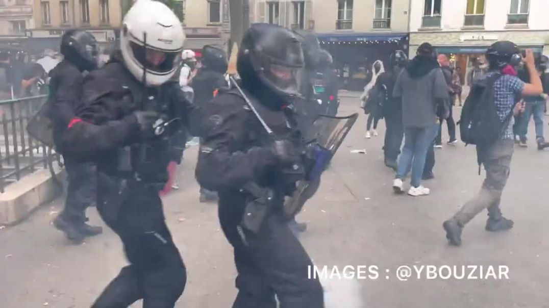 Police in Paris, France take over restaurant terraces to arrest individuals.