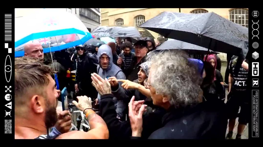 (EMB) WORD ON THE CURB - PIERS CORBYN QUESTIONED BY PROTESTORS OVER CASH SCANDAL (09/08/21)