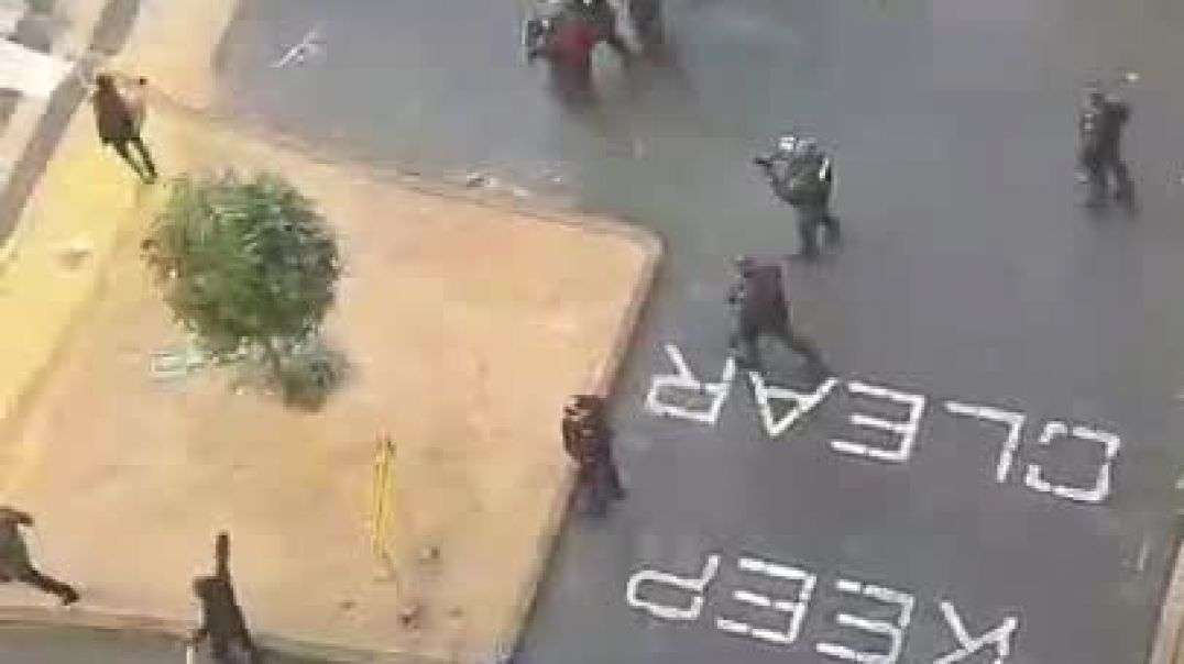 AN ARIAL VIEW OF POLICE SHOOTING AT CONSTRUCTION WORKERS IN MELBOURNE
