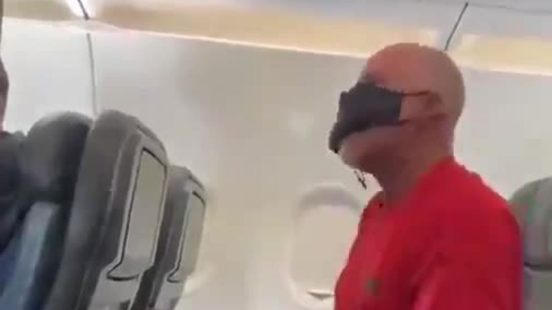 real life zombie on a plane ! mask meltdown LOL