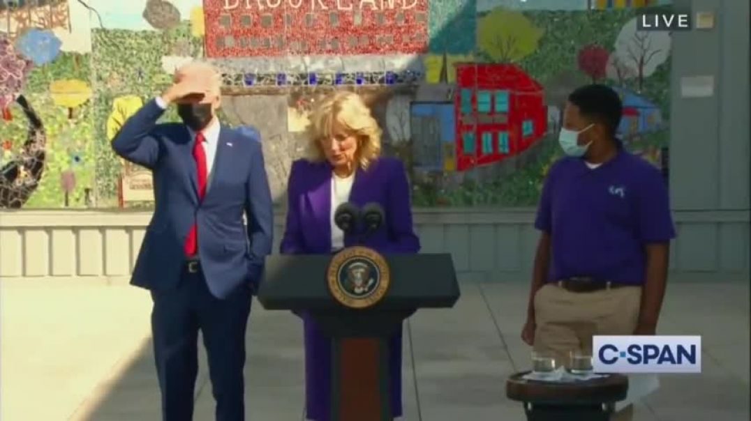 LUNATIC Biden wanders off whilst his wife is giving speech - the staff had to kick his tired ass bac