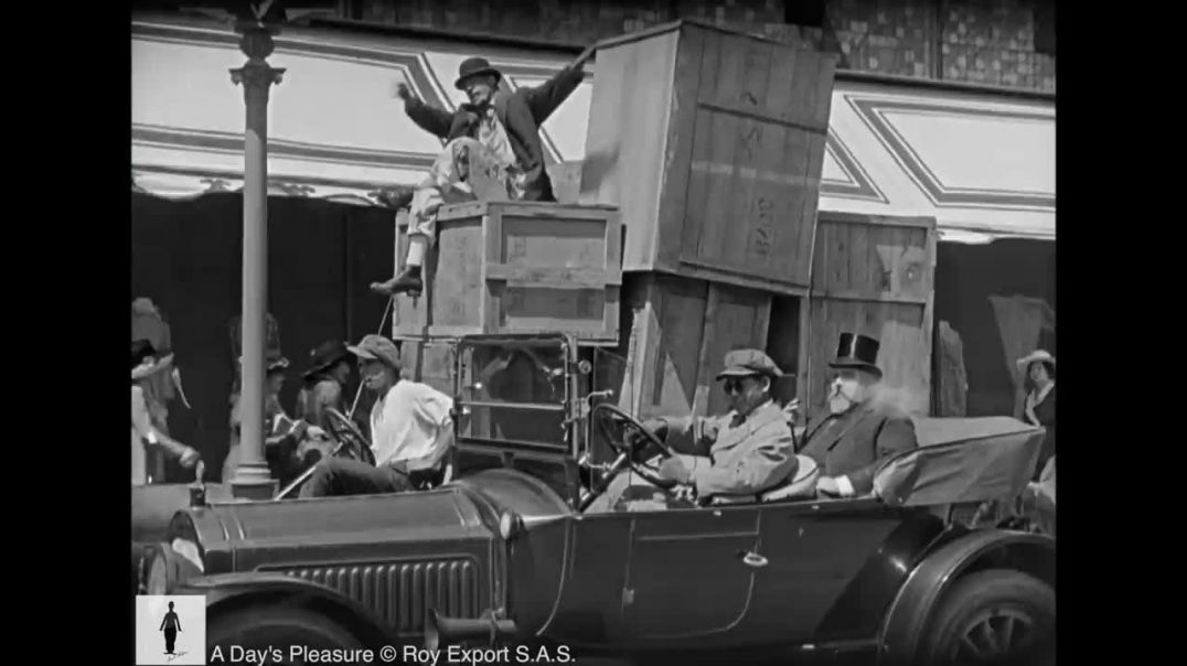 Charlie Chaplin trapped in tar - A Day's Pleasure (1919)