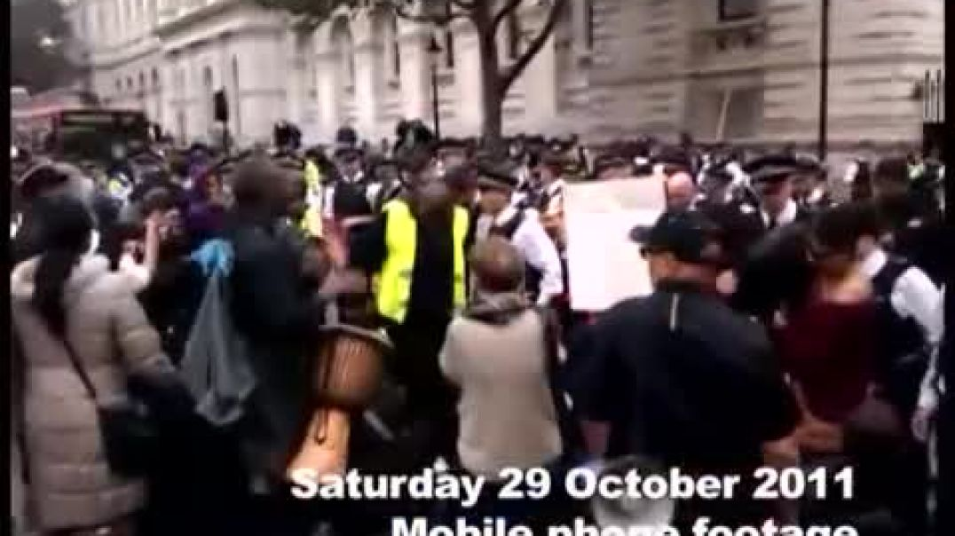 Police try to silence The United Friends and Family Campaign march to 10 Downing Street