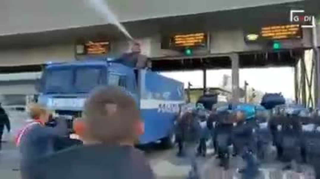 Trieste Italy workers strike against covid passports dictator mayor orders police to clear the port