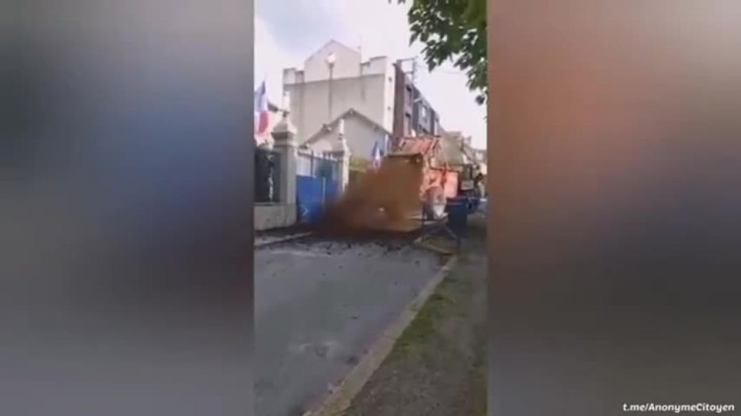 French Farmers protest high petrol prices by throwing shit outside government buildings